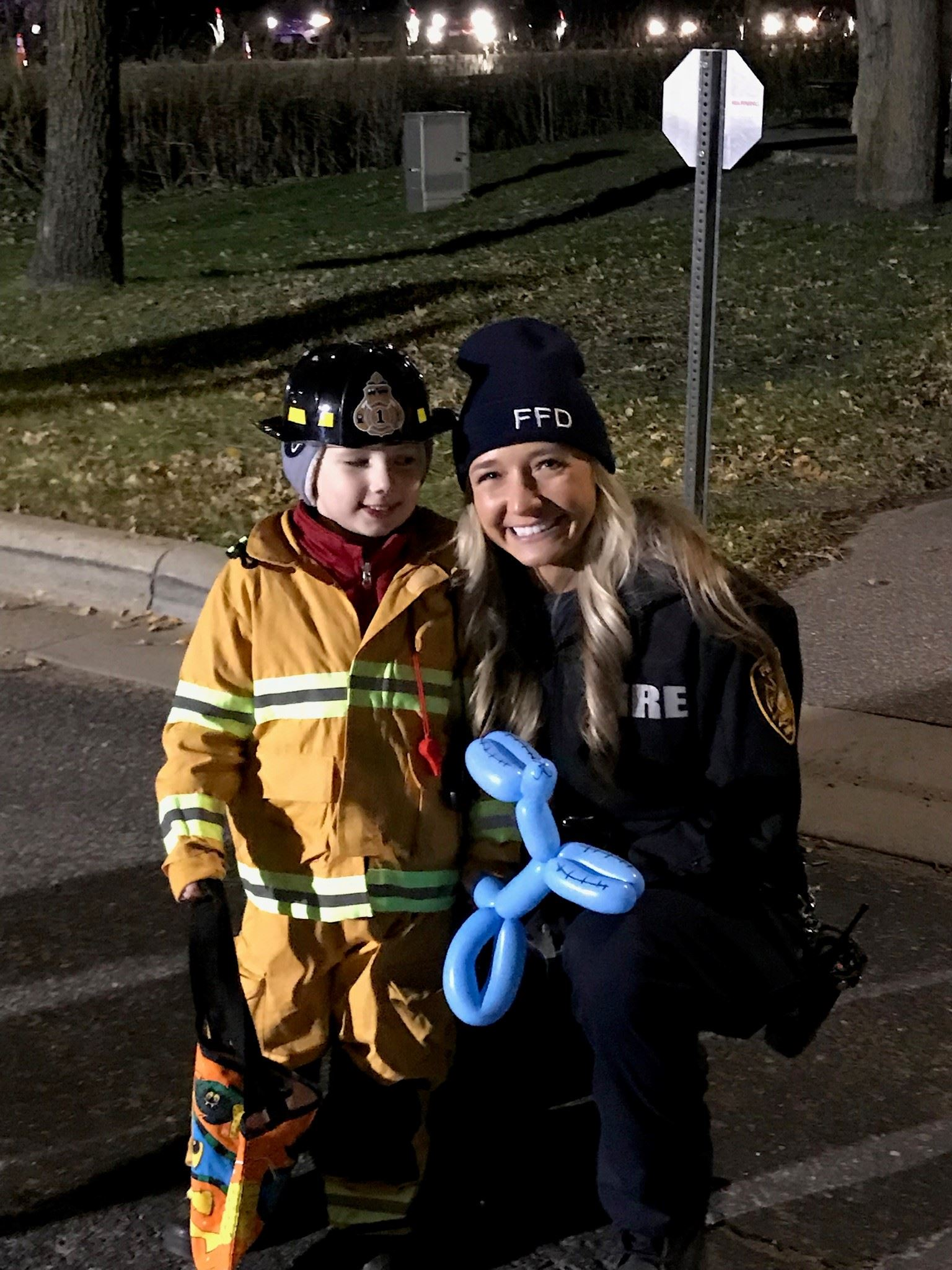 Female firefighter with child